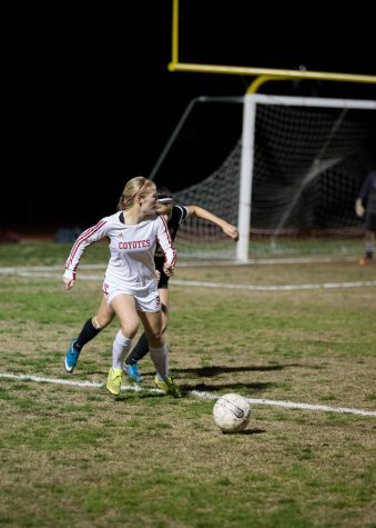 Forward Junior Macey Williamson (3) dribbles the ball away from a Washington defender during Tuesday