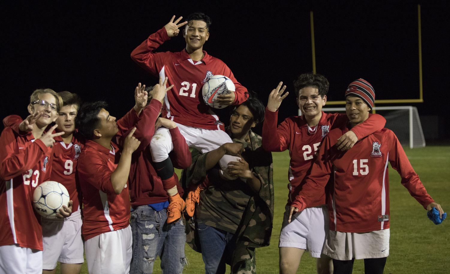 Sophomore Diego Soto Esquivel holds up three fingers in celebration of completing the hat-trick.