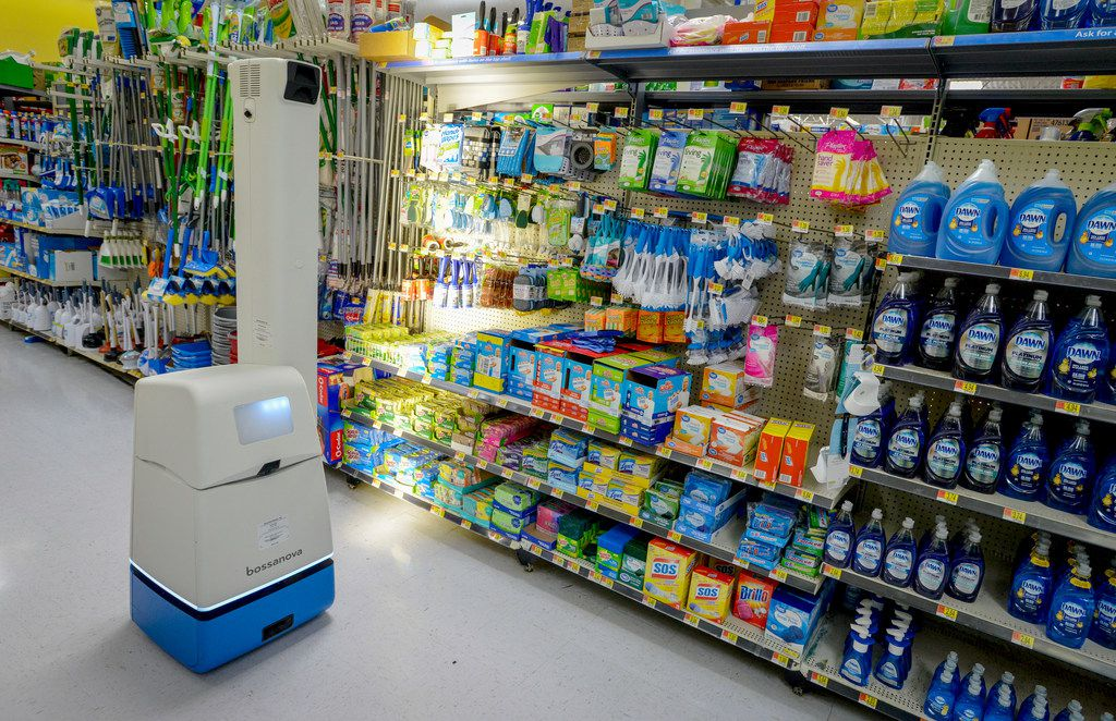 A robotic shelf scanner moves along an aisle at a North Richland Hills Walmart
