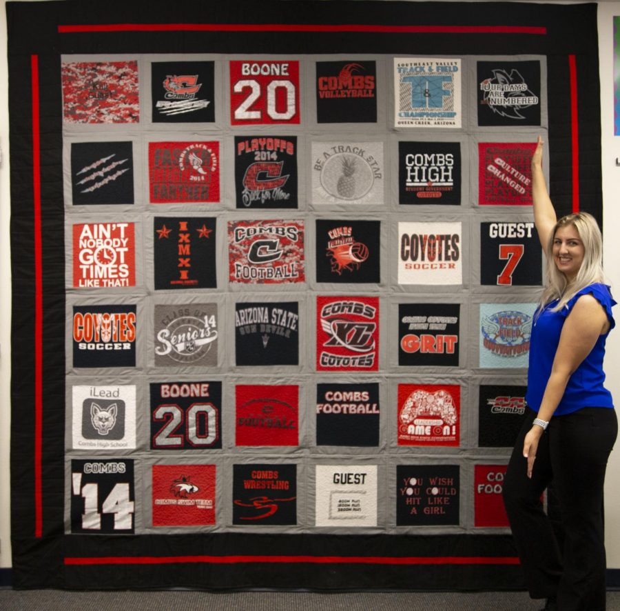 Kali+Guest+stands+by+her+quilt+made+of+all+of+her+t-shirts+from+her+high+school+experience.