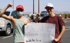 Seniors Chad Moyes and Cameron Ricks march down Germann Road holding a sign that implies they have forgotten how to spell because of virtual learning. Community members marched from Combs High School to the J. O. Combs Unified School District Office in protest of the decision to cancel school due to more than 100 staff calling in sick over safety concerns related to COVID-19.