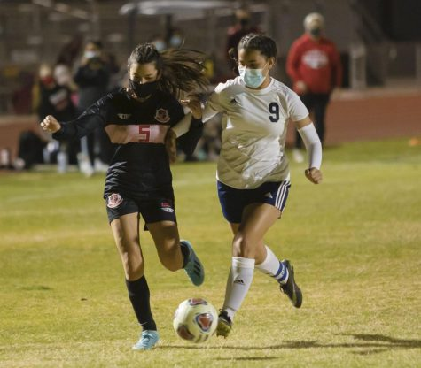 Forward Miriana Larios faces against (#9) from Shadow Mountain Matadors, attempting to get the ball upfield during the second half.