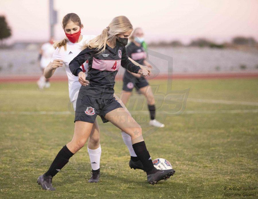 Forward back Taylor Beckstrom (4) tries to steal the ball away from Seton Catholic forward Stephanie Cosentino (13).