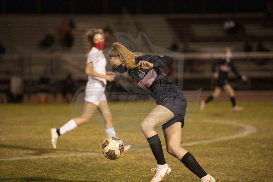 Senior forward Lexi Schnepf (10) saves the ball from going into the Coyotes defensive end.