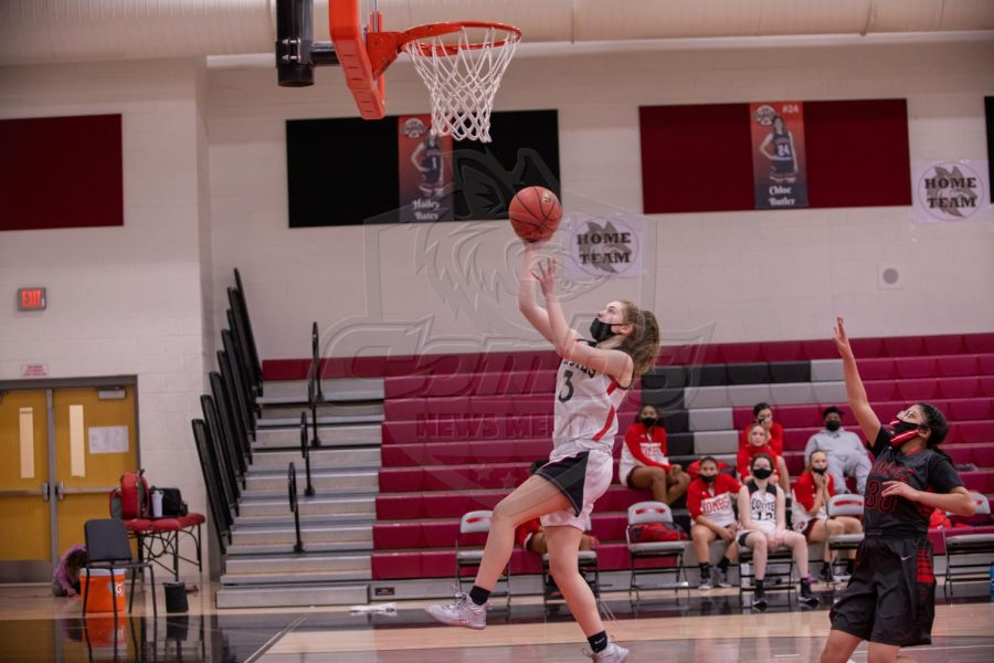 Sophomore McKayla Wiltsie (3) goes for a lay up during the second half of the game.