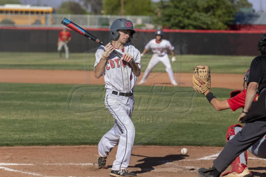 Junior Trip Rasmussen attempts to swing at the ball from Seton Catholic.