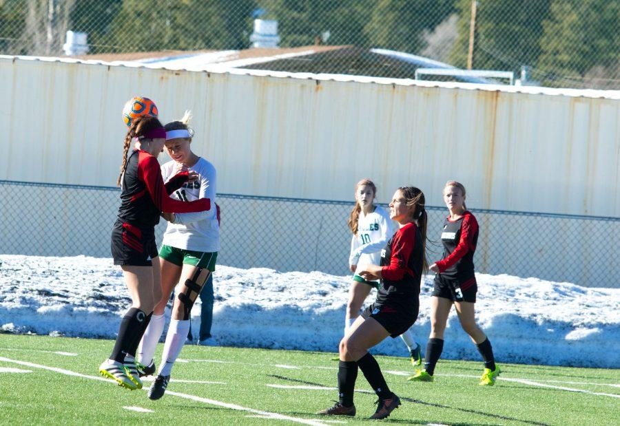Defender Sarah Hicks (#8) and Shelbie O'connor (#11) trying to head the ball.