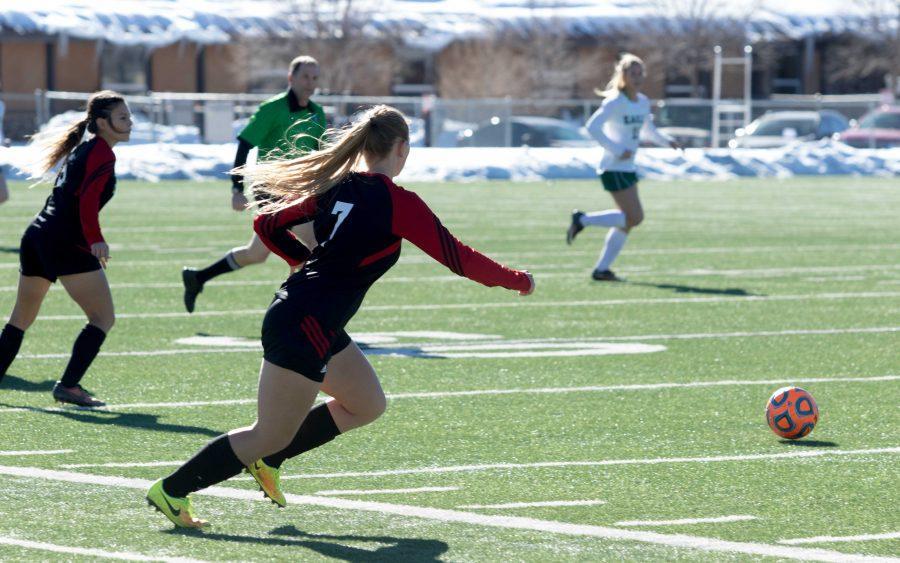 Defender Kayla Fairbanks (#7) running towards the ball against the Flagstaff Falcons.
