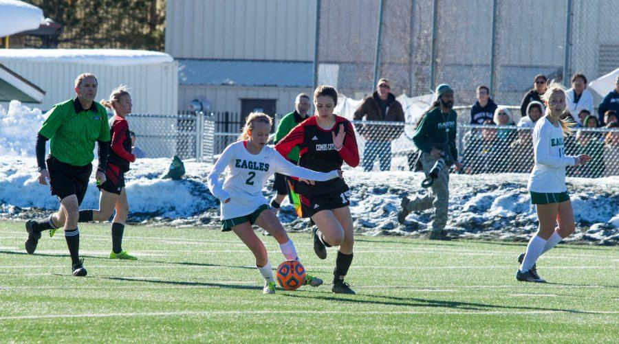Midfielder Makenzie Cloud (#15) attempts to take possession of the ball from Liz McDonough (#2).