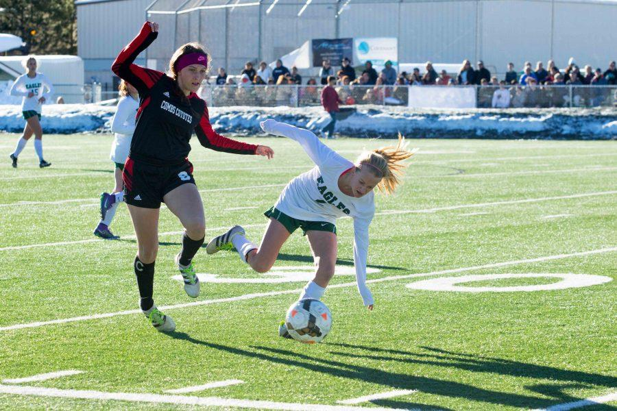 Defender Sarah Ricks (#8) and Liz McDonough (#2) battling it out on the field.