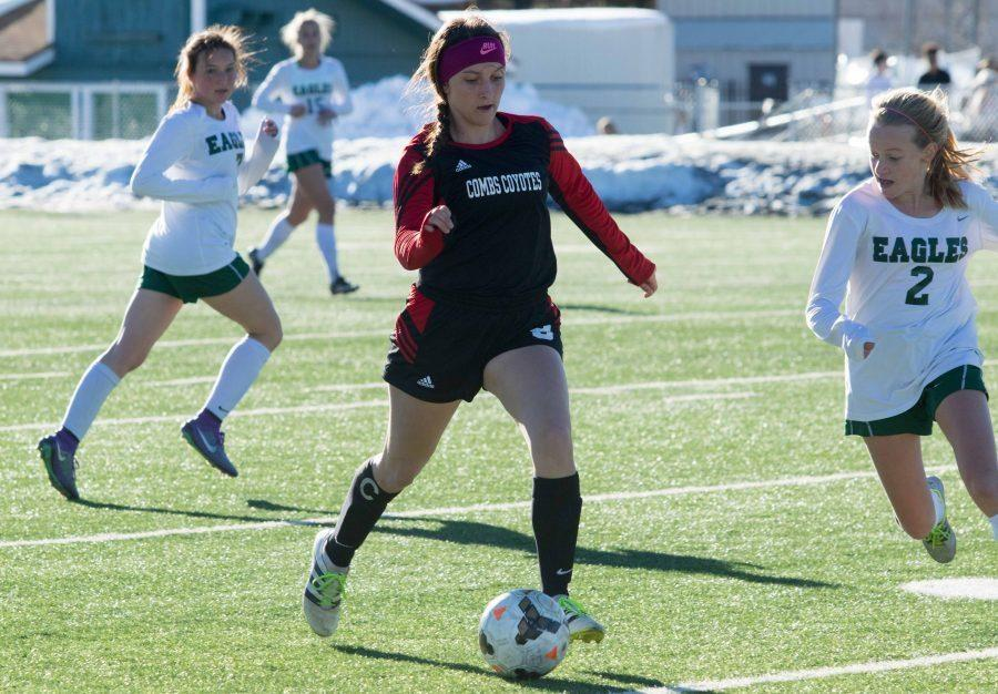 Defender Sarah Ricks (#8) dribbling the ball down field in the first round of state playoffs.