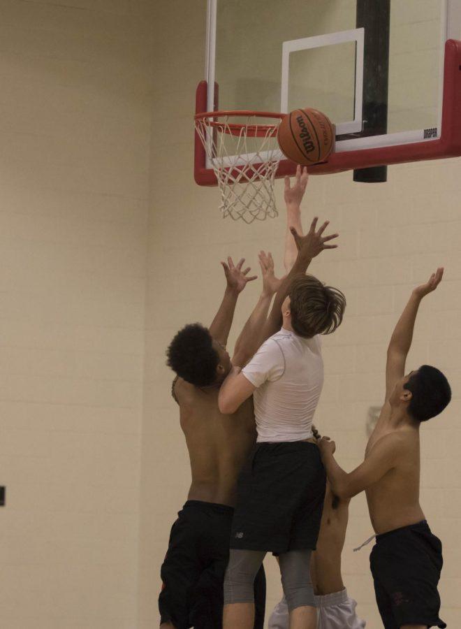 Ian Likens (Jr.) shooting a lay-up during varsity basketball practice.