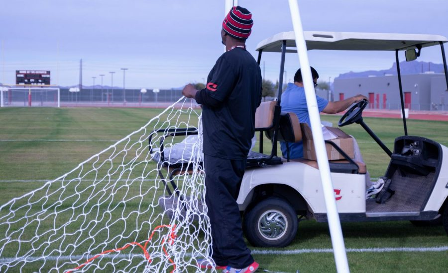 Slocum putting up the soccer net for the home game at Combs.