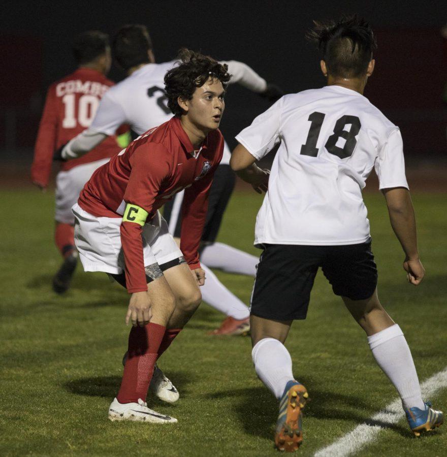 Senior Adrian Alcaraz defends against a penalty kick.